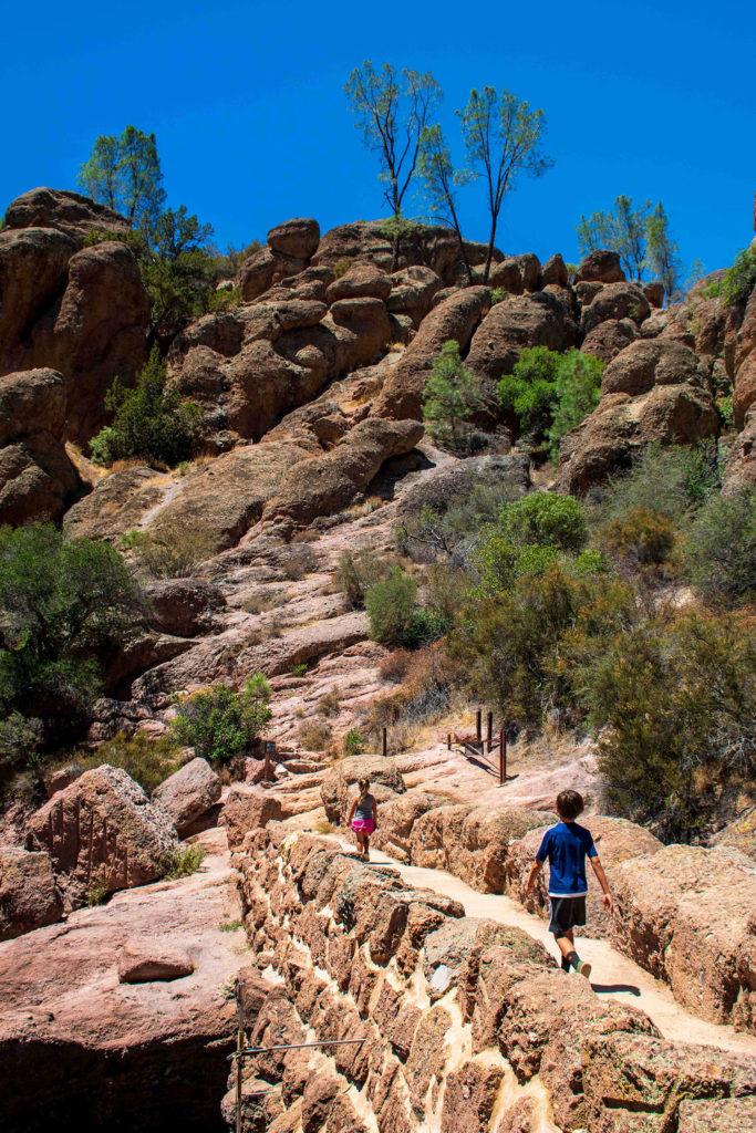 Photo of kids hiking across a bridge at Pinnacles