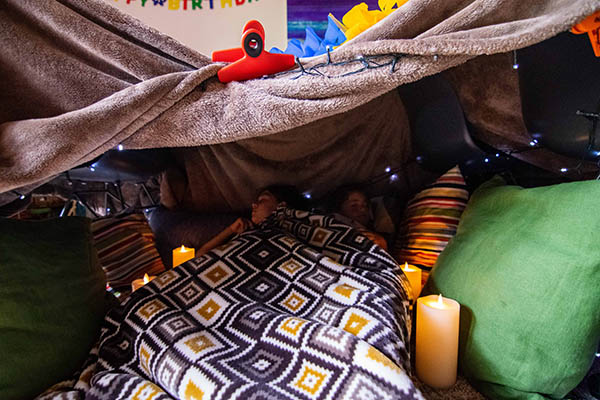 Photo of kids in a homemade tent